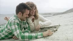MS Couple playing on beach Stock Footage