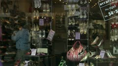 MS Couple window shopping at shoe shop - stock footage
