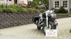 MS PAN Harley Davidson with For Sale sign on driveway Stock Footage