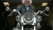 MS TU Portrait of senior man on Harley Davidson Stock Footage