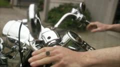 CU Senior mans hands on Harley Davidson handlebar Stock Footage