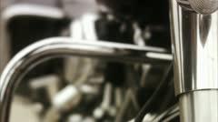 CU TU Senior man polishing Harley Davidson Stock Footage