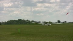 Competitor pilot and glider take off in the air on the way to start point Stock Footage