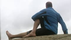 Man doing stretching exercises Stock Footage