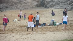 International visitors playing beach volleyball On beach. Stock Footage