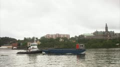 Towboat taking a barge on tow Stock Footage