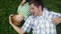 CS MS HA Father and son lying on grass Stock Footage