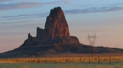 Sunrise in New Mexico, rock formation nr Monument Valley, natural light at dawn Stock Footage