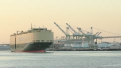 RORO Ship Leaves Port at Sunset Stock Footage