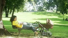 Man with a pram in a park Stock Footage