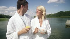 MS People in bathrobes meeting on jetty Stock Footage