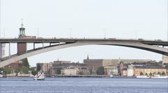 Sailing-boat passing by in front of a bridge, Stockholm Stock Footage