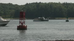 Motor Boats Navigating Ocean Waterway past Buoys - stock footage