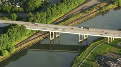 Highway Bridge and Reflection on Warm, Summer Afternoon - Aerial View - stock footage