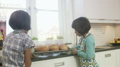 MS Two sisters holding fresh bread Stock Footage