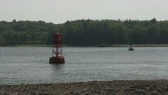 Motor Boat Speeds Between Navigation Buoys Leaving Huge Wake - Wide Angle Stock Footage