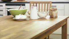 WS TU Baking ingredients on kitchen table Stock Footage