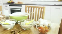 WS Baking ingredients on kitchen table Stock Footage