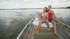 WS Couple boating on lake Stock Footage
