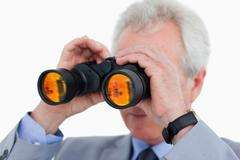 Close up of tradesman looking through binoculars Stock Photos