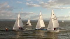 Dinghies racing round buoy Stock Footage