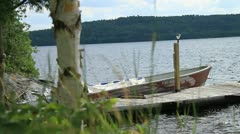 Small Aluminum Fishing Boat Tied to Dock Stock Footage