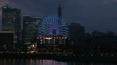 Cosmo Clock 21, Ferris wheel, at twilight, Yokohama, Japan Stock Footage