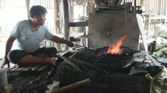Blacksmith's shop on Inle lake - stock footage