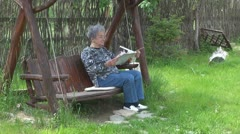 The old woman relaxing on vacation Stock Footage
