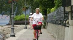Elderly woman biking Stock Footage