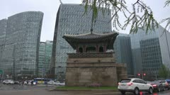 Korean Temple surrounded by modern buildings, Seoul, South Korean Stock Footage