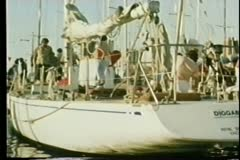 Yacht docked in harbor Stock Footage