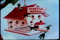 Fade in Magpie Hotel birdhouse hanging on tree Stock Footage