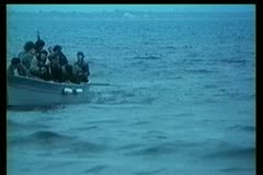 Wide shot of people sitting in  rowboat Stock Footage
