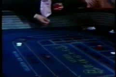 Man tossing dice on craps table in casino Stock Footage
