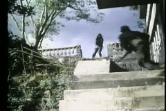 Low anlge view of soldiers battling on staircase Stock Footage