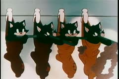 Kittens hanging from socks on clothes line shooting guns Stock Footage