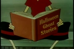 Close-up person reading halloween ghost stories Stock Footage