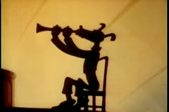Silhouette of dog playing the clarinet Stock Footage