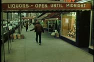 Stock Video Footage of Rear view of people walking down New York City street