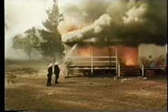 Firefighters extinguishing house fire Stock Footage