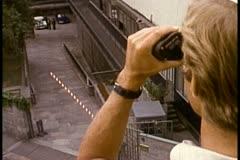 Man looking through binoculars Stock Footage