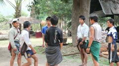 Young adult play ball in Samkar village Stock Footage
