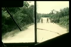 View from inside bus running through military checkpoint - stock footage