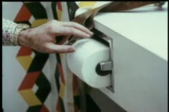 Close-up  man pulling out a large amount of toilet paper Stock Footage