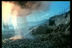 Bombs exploding on beach during gun battle Stock Footage