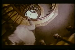 High angle view two men running up spiral staircase Stock Footage
