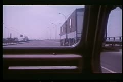 View out of moving car while passing an 18 wheeler - stock footage