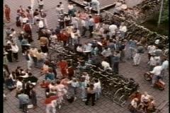 Aerial shot of  people walking around  by bicycle racks Stock Footage