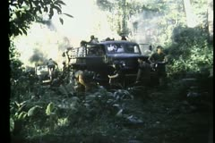 Soldiers in jungle unloading  truck Stock Footage